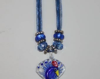 Blue Peackock Murano Glass Pendant.  Matching Cord with  Large Hole Beads.  Ribbon can be replaced with  Braided Leather Cord if requested.