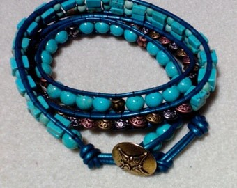 Turquoise Colored Leather 3 wrap Bracelet
