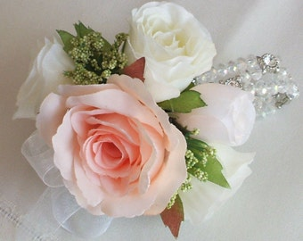 georgeous peach and white Wedding Wrist Corsage. Crystal and diamante bracelet