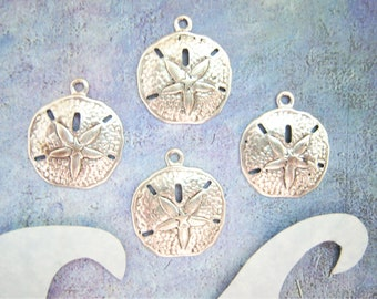 Antique silver plated sand dollar charms, lot of (4) - YW134