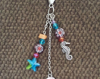 Beachy purse and tote bag charms, dangles, tassels and decorations.