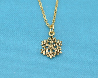 "Girl's, Teen Girl's or Woman's snowflake necklace in gold plated pewter on a 16"" gold stainless steel cable chain with two inch extender."