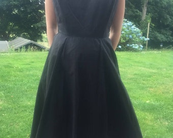 Vintage: Early 1960s black fit and flare dress.