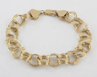 14k Yellow Gold Charm Bracelet With Triple Link Ring Links 7 Inches 12.2 grams