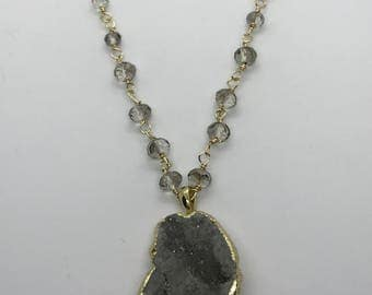 Crystal pendant necklace in smokey grey