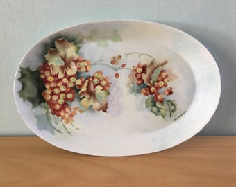 Lovely 1950s Bavarian Hutschenruether Selb oval Noblesse serving bowl adorned with rustic gold & burgundy grapes against a cloudy blue sky!