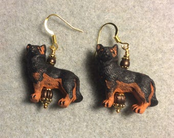 Black and brown ceramic German shepherd dog bead dangle earrings adorned with brown Czech glass beads.