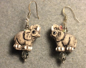 Grey and white ceramic elephant bead earrings adorned with clear Czech glass beads.