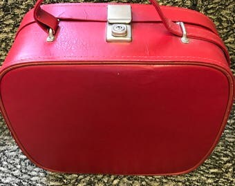 Vintage red leather over night case