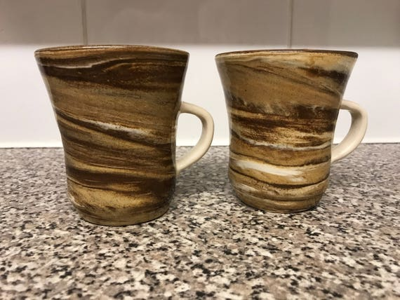 Two hand thrown mugs