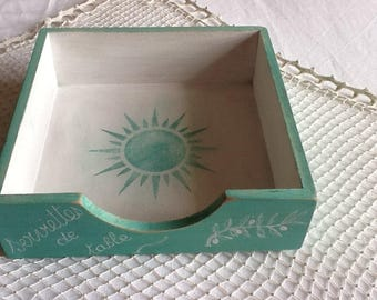 Paper towel holder decorated with a Sun and writing