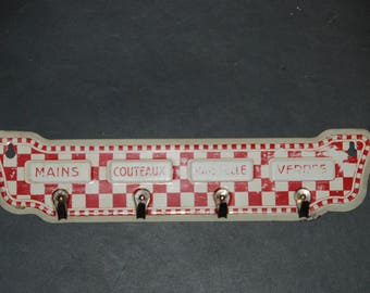 French vintage kitchen towel hooks. Dish cloth holder in red and white chequered lustucru painted tole. French kitchen.