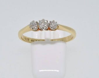 18ct yellow gold and platinum 0.20ct graduated diamond 3 stone ring size M 1/2