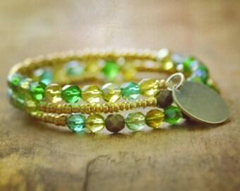 Beaded memory wire bracelet with added custom charm