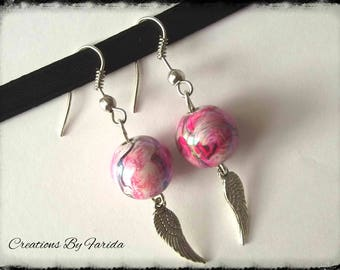 wave earrings with a wing pendant and a Pearl Pearly pink effects