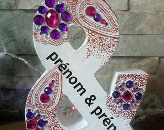 Symbol & decorated by hand to put on the bride and groom table or cake