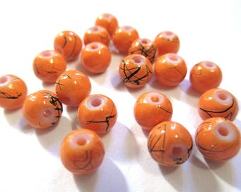 20 orange, black beads 6mm