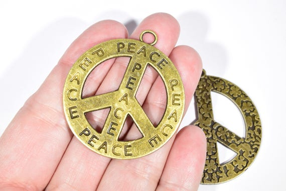 2 peace sign charms two different peace signs large peace sign 2 peace sign charms two different peace signs large peace sign charms peace sign pendants bronze peace signs hippy charms bc1864 from mozeypictures Image collections