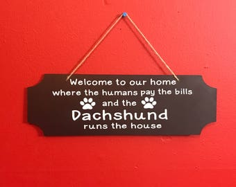 Dachshund Runs The House Wooden Sign