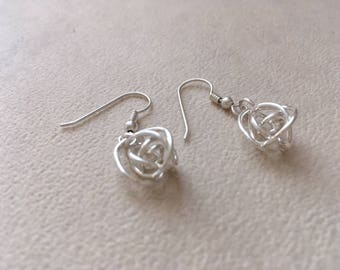 Argentium Silver lovers knot dangle earrings.