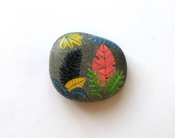 Pebble painted colorful fall leaves