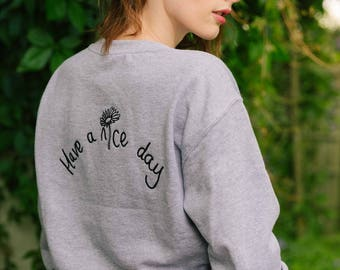 Embroidered Have a nice day slogan daisy sweater