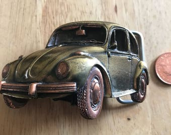 Bergamot belt buckle VW Beetle P-41. Made in USA 1980. Very good condition. Size ~80x50 mm