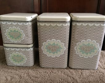 Vintage canister set.  1980's shabby and lacy set for kitchen counter or pantry storage.