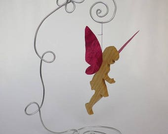 Wooden fairy and paper to ask