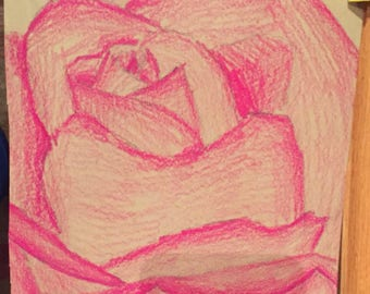 Magenta-colored pencil on tan sketch paper