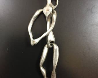 Large sterling silver moveable figure pendant
