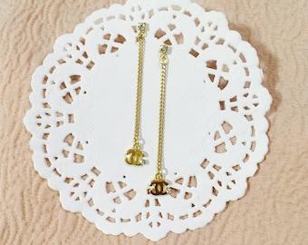 Channel style gold chain drop earrings