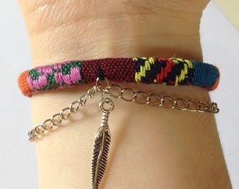 woven bracelet chain and feather
