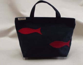 a small bag Navy with two red sardines