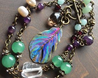 Garden variety semi precious gemstone necklace with feather pendant