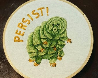 """Hand Embroidered 6"""" Wooden Hoop full of Tardigrade Toughness for 2018. Persist!"""