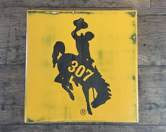 Bucking Horse 307 - Wood Sign - University of Wyoming - Bucking Horse and Rider - Officially Licensed UW Product