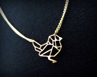 Origami bird in antique gold necklace