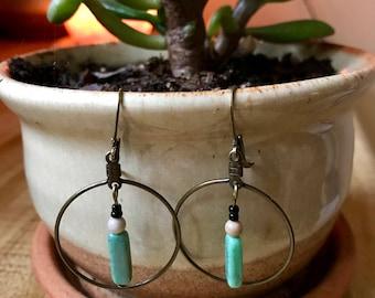 Bronze hoop / turquoise hanging bead.