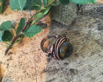 Copper glass bead wrapped ring.