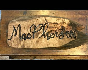Hand carved name sign