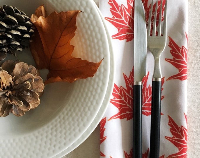 Set of four organic cotton dinner napkins, maple leaves in red