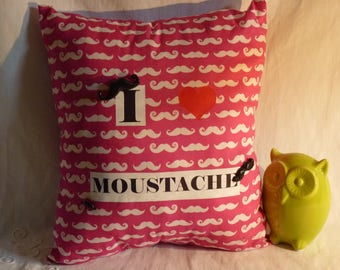 Pink mustache on bottom cushion