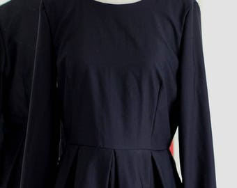 Tunic with pleated basque peplum