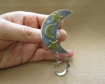 Vintage brooch in crescent and star form