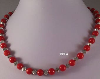 Necklace coral beads 8 mm and Tibetan silver square beads.