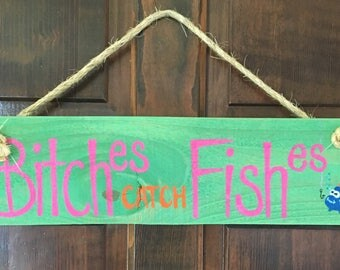 Wood and rope sign