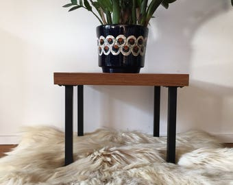 70's flower stool in teak finish with metal legs