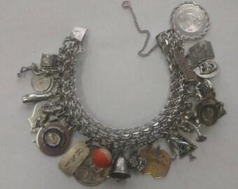 vintage solid sterling silver charm bracelet