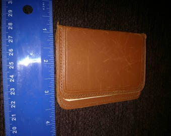 Vintage leather scratch pad with original identification card.